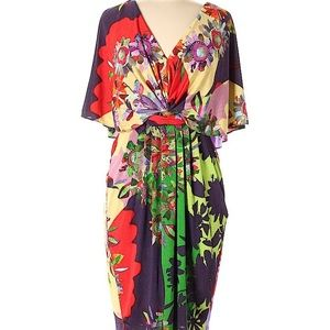 Ranna Gill back view floral flutter sleeve dress